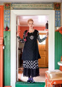 A fellow pinner pinned this photo because of the lovely painting around the doorframe.  However, I'm pinning it because of the dress on the model! Great layered dress that is so flattering for any body type. LJH