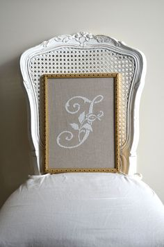 A simple, elegant French cross-stitched monogram pattern done with white silk on natural linen. Shabby Chic Darcy Chair.