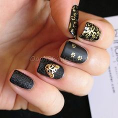 Super edgy black and gold nails with 3D cat charm