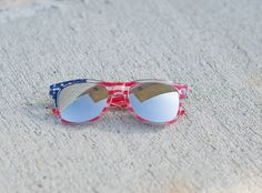 These sunglasses are a great way to spice up an outfit or for Fourth Of July! Ray Ban style with silver tint and reflective lenses!