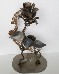 Metal sculpture of a rose by E.L. Roberts