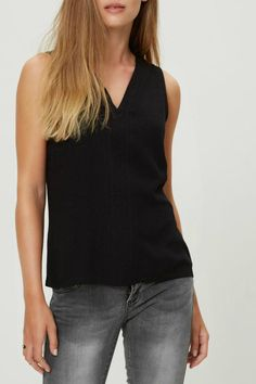 Feminine sleeveless and V-neck top with stylish buttons down the back. The textured viscose gives the top more detail and gorgeous drape. The back splits into a V shape giving it more room for the bum.   Hester Top by Vero Moda. Clothing - Tops - Sleeveless Canada