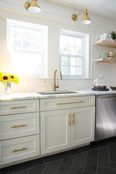 White and gold kitchen features white shaker cabinets adorned with brass pulls p. White and gold kitchen features white shaker cabinets adorned with brass pulls paired with calcutta White Shaker Cabinets, White Kitchen Cabinets, Kitchen Redo, New Kitchen, Kitchen Dining, Kitchen White, Kitchen Ideas, Farmhouse Cabinets, Kitchen Cupboard