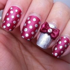 Dotticure nails with bow accent