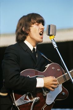 British singer, composer and musician George Harrison playing guitar and singing during the concert of British band The Beatles at the Velodromo Vigorelli. Milan, June Get premium, high resolution news photos at Getty Images George Harrison, Patti Harrison, Guitar Tips, Guitar Songs, Guitar Lessons, Guitar Quotes, Guitar Chords, Gretsch, Ringo Starr
