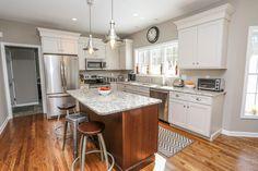 Traditional Kitchen with Pendant light, MS International Granite Blanco Tulum, Flat panel cabinets, L-shaped, Hardwood floors