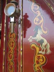 Horse details on red gypsy caravan door...