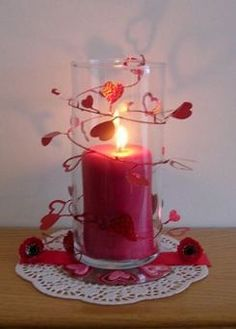 Super easy - wrap valentines garland around a hurricane glass/jar and insert candle
