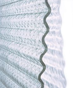 Corrugated wire glass sheets