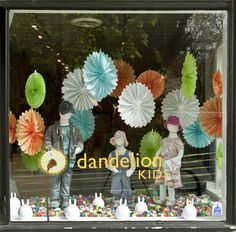 Window Display - Love the hanging paper flowers.