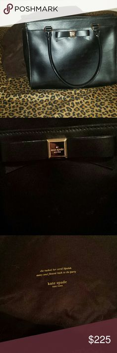 Kate Spade Shoulder Handbag with dust cover Beautiful, soft,  shiny solid black authentic Kate Spade Shoulder bag.   Bow on the front, gold hardware,  bright hot pink lining.   Gently used,  excellent condition,  easily maintenance! kate spade Bags Shoulder Bags