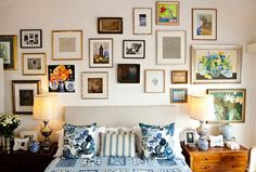 anna spiros, gallery art around headboard, upholstered square headboard, neutral bedroom, lots of art