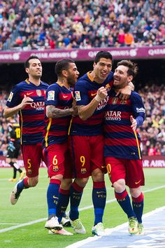 Sergio Busquets Dani Alves and Luis Suarez celebrate with their teammate Lionel Messi after scoring the opening goal during the La Liga match between...