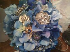 Had family from each side donate broochs for my wedding bouquet! It was beautiful and will be an heirloom :)