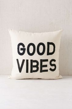 To go on the couch: Magical Thinking Good Vibes Pillow - Urban Outfitters