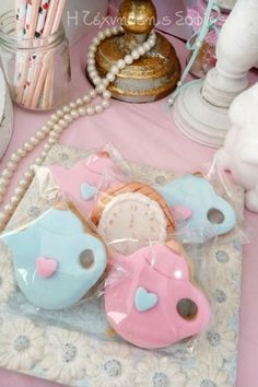 Take a look at this magical Alice in Wonderland baptism! The cookies are so much fun!! See more party ideas and share yours at CatchMyParty.com    #catchmyparty #partyideas #aliceinwonderland #cookies#aliceinwonderlandparty #baptism #teaparty