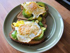 avocado toast with over easy fried egg. - Looks like a good breakfast sandwich.