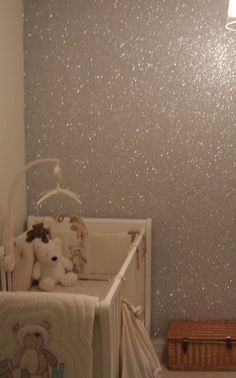 Mix a gallon of glue with your choice of glitter and then paint with it. The glue will dry clear making a glittery wall!