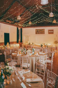 Light ceiling garlands to brighten up a village hall for Winter's day or Christmas wedding - you don't need loads!