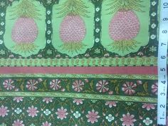 Vintage 1980 Waverly Schmacher Fabric titled Les Exotiques. Lovely print featuring pineapples and flowers on a green background. This fabric would be a great addition to your home as window treatments, table top, pillows, and accessories.  The pineapple border is on both sides and measures 8 inches in width.  100% cotton  48 wide  Sold by the yard. If you buy more than 1 yard, I will adjust the shipping costs accordingly so you only pay for the actual shipping cost.  Thank you for visiting…