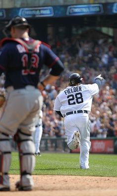 Prince Fielder #28 of the Detroit Tigers hits a three-run home run in the eighth inning as catcher Ryan Doumit #18 of the Minnesota Twins looks on during the game at Comerica Park on July 5, 2012 in Detroit, Michigan.