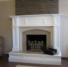 Oxford Mantel, new granite facing and a custom Hearth-wrap were featured in this fireplace remodeling project.