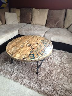 Upcycled wire wood spool turned into gameroom coffee table from Reclamation Garage.