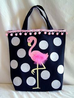 I don't like the pom pom trim but I LOVE this bag. Might make it for my sister that loves flamingoes.