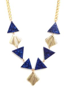 """We've always fallen head over heels for Art Deco inspirations and here's another case-in-point why. The triangle """"beads"""" are wonderfully graphic, especially made from pleated gold and blue gems, while the long chain links up the glam quotient.  This is part of the Designer Pop-Up: AV Max Collection.  All AV Max orders over $50 receive a free Gold Cable Cuff, while supplies last.  Simply add the gift to your cart last and enter the code AVMAX at checkout."""