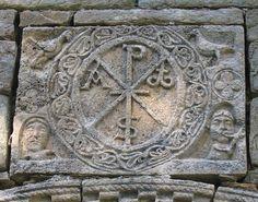 More details Chi-Rho symbol in relief (12th century), Santa Maria de Cóll church, Vall de Boí, Catalonia, Spain