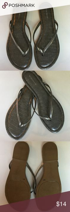 BCBGeneration Sandals  BCBG generation sandals in silver. Soles look like alligator skin. Flip flop style. Size 7. Uppers in new condition. Little wear on bottom. Size tags still on. BCBGeneration Shoes Sandals