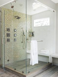 "What a great shower concept! We love the openness of this shower with the two large glass panels. We also love the ""wood"" tile floor, such a classy alternative to some of your other options. This is a great way to start your morning!"
