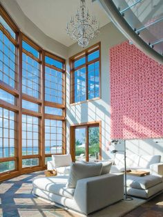 Natural Effects - 8 Pink Decorating Ideas for Living Rooms on HGTV -Those windows are to die for!- #HGTV