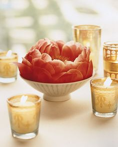 Place single peonies in porcelain bowls and surround with festive votive candles for a unique and romantic centerpiece #wedding