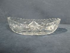 A beautiful stunning dish that has a flat top edge smooth edge and smooth inner sides and bottom. The starburst cuts are on the exterior as well as the side cuts. A very wonderful dish any collector would be proud to own. Pressed Glass, Holiday Tables, Clear Glass, Decorative Bowls, Daisy, Pottery, Decorations, Dishes, Flowers