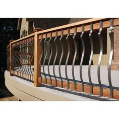 Can be used with wood and composite deck railing systems. The rectangular balusters cost slightly more than wood balusters but they won't warp, split, or splinter like wood. Deck Balustrade Ideas, Composite Deck Railing, Deck Balusters, Balustrades, Railing Ideas, Banisters, Wrought Iron Porch Railings, Front Porch Railings, Patio Railing