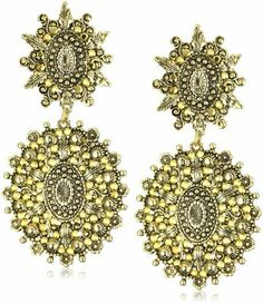Yochi Gold Chandelier Stone Burst Earrings Yochi. $68.00. Made in United States. Double floral circles with 14k Antique Gold Plating. Post Earring. Gold crystals radiant subtlety