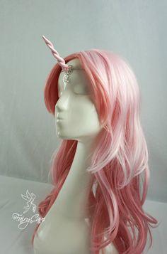Iridescent pink unicorn horn tiara by FairyCaveShop on Etsy https://www.etsy.com/listing/514250562/iridescent-pink-unicorn-horn-tiara