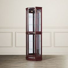 Features:  -Includes 4 adjustable and 1 fixed tempered glass shelves.  -Adjustable levelers.  -Material: Metal with rubber covering(Studs where the shelves rest).  Product Type: -Curio cabinet.  Desig