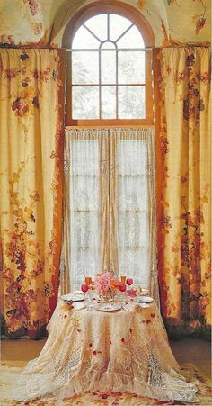 Gorgeous windows, curtains and table in dining room.
