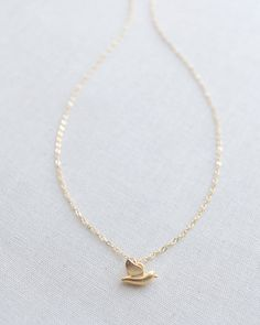 Tiny Gold Bird Necklace by Olive Yew, $41. Also available in silver. #greatgiftideas