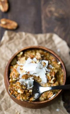 Overnight Crock Pot Carrot Cake Oatmeal is an easy, healthy slow cooker breakfast recipe that cooks while you sleep! Vegan and gluten free, too.