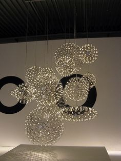 Moooi Lighting, Raimond group pendant lights. Love these... look like fireworks!