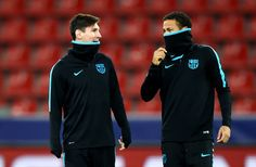 Lionel Messi speaks to Neymar during a FC Barcelona training session on the eve of the UEFA Champions League groupe E match against Bayer Leverkusen at BayArena on December 8, 2015 in Leverkusen, Germany.