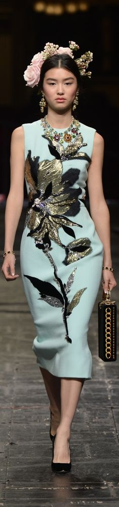 Yikes, accessorize much?! The styling totally detracts from what is otherwise a GORGEOUS garment! -Dolce & Gabbana Spring 2016 Couture
