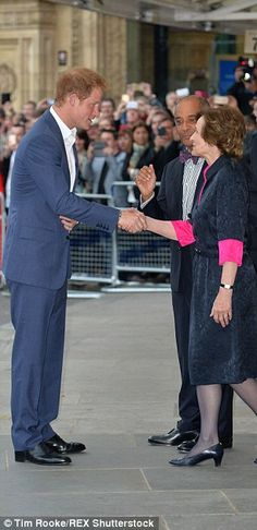 Greetings: Prince Harry - a patron of the charity - shook hands with dignitaries as he arr...