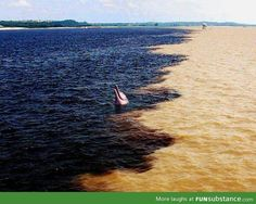 """meeting of the waters"", the amazon river meets the rio negro in brazil"