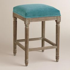 One of my favorite discoveries at WorldMarket.com: Peacock Paige Backless Counter Stool- island area