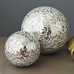 Mirrored mosaic spheres: