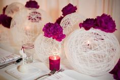 Katrina this would be so easy and so pretty to hang from the ceiling with those fake tealights inside. Balloons, string, and fabric stiffener.